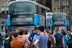 Edinburgh, Scotland, UK. 2nd August, 2018. At the start of the Edinburgh Festival many tourists are arriving in the city , however, many people are also leaving the city and heading to the airport, as this long queue for the airport Express 100 bus shows.