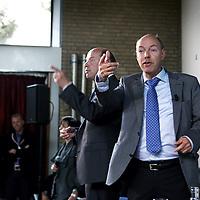 Nederland, Achlum , 28 mei 2011..Conventie van Achlum..Achmea bestaat dit jaar 200 jaar. In dit jubileumjaar gaat Achmea terug naar haar roots: het Friese dorpje Achlum. Op 28 mei vindt daar de Conventie van Achlum plaats. Zo'n 2000 mensen gaan daar met elkaar in gesprek over de toekomst van Nederland binnen de thema's: veiligheid, mobiliteit, arbeidsparticipatie, pensioen en gezondheid. Dit doen we met top sprekers uit de politiek en wetenschap maar ook met mensen zoals jij..Op de foto de 2 strafrecht advocaten Hans en Wim anker. In het midden hun neef de opinipeiler Hans Anker.Foto:Jean-Pierre Jans