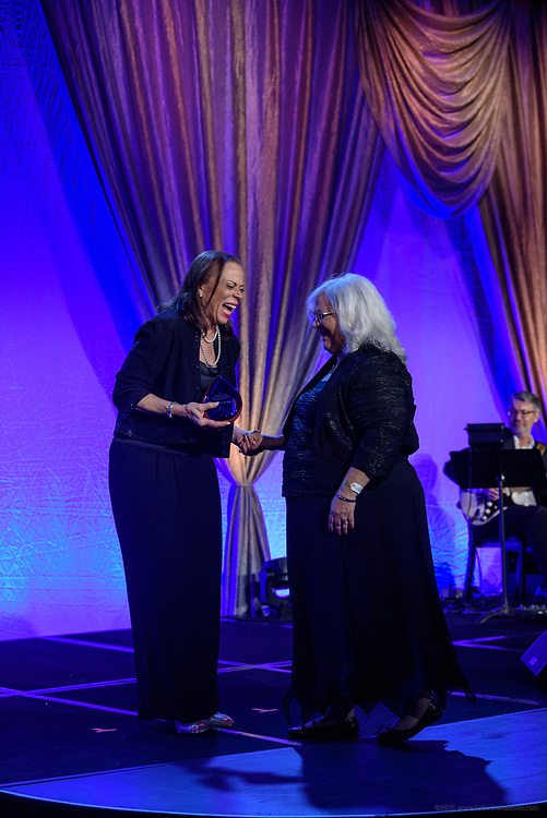 Lonnie Ali, widow of Muhammad Ali and Co-Founder of the Muhammad Ali Center, presents the Muhammad Ali Humanitarian Award for Social Justice posthumously to Heather Heyer, and received by her mother Susan Bro at the fifth annual Muhammad Ali Humanitarian Awards Saturday, Sept. 23, 2017, at the Marriott Louisville Downtown in Louisville, Ky. Heyer lost her life Saturday, Aug. 12, 2017, in Charlottesville, Va., while fighting for her beliefs and campaigning against hate. (Photo by Brian Bohannon/Invision for Muhammad Ali Center/AP Images)