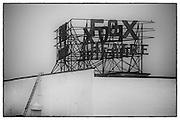 Fox Theatre sign breaks through heavy early morning fog. Fullerton, CA.