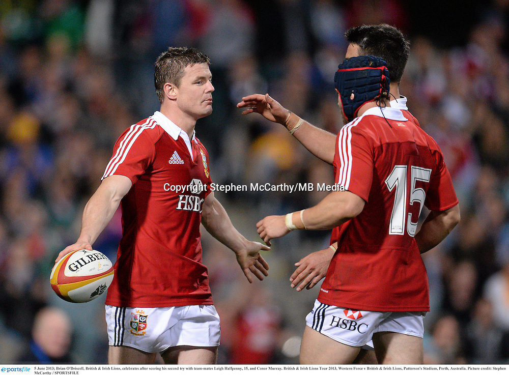 5 June 2013; Brian O'Driscoll, British & Irish Lions, celebrates after scoring his second try with team-mates Leigh Halfpenny, 15, and Conor Murray. British & Irish Lions Tour 2013, Western Force v British & Irish Lions, Patterson's Stadium, Perth, Australia. Picture credit: Stephen McCarthy / SPORTSFILE