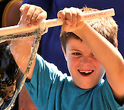 A young boy makes bubbles at the Earth Day celebration at Reid Park, Tucson, Arizona, USA.