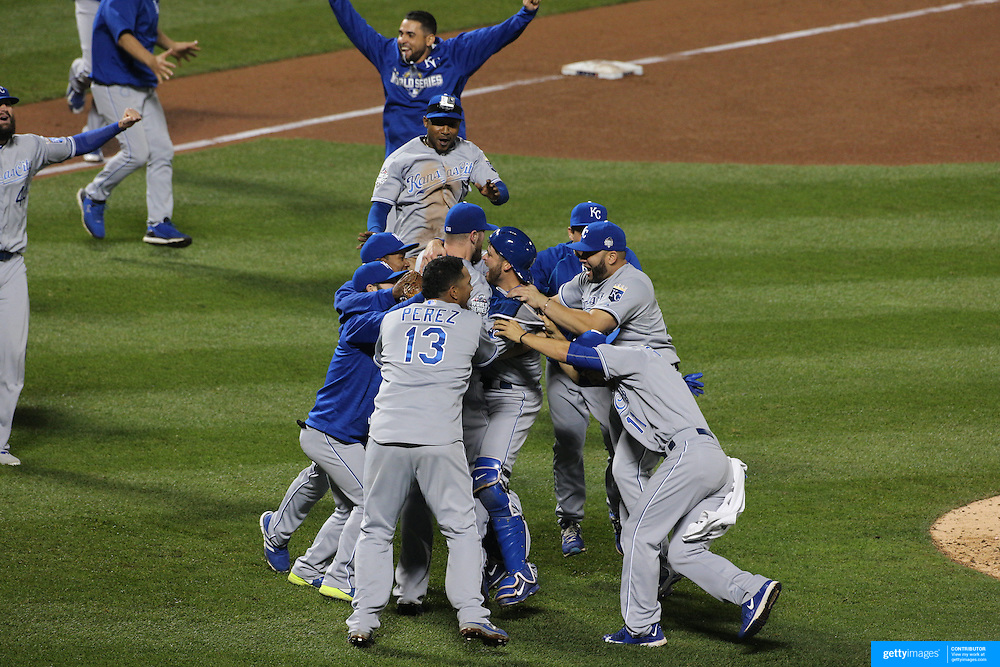 Jubilation as closing pitcher Wade Davis is mobbed by teammates as Kansas City Royals win the World Series and empty the dugout during the New York Mets Vs Kansas City Royals, Game 5 of the MLB World Series at Citi Field, Queens, New York. USA. 1st November 2015. Photo Tim Clayton