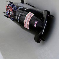 28 February 2007:      The Great Britain 2 bobsled driven by John James Jackson with sidepushers Henry Nwume and Keith Mclaughlin, and brakeman  James Devlindrive through turn 20 in the 1st run at the 4-Man World Championships competition on February 27 at the Olympic Sports Complex in Lake Placid, NY.