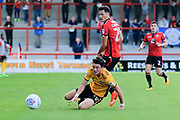 Eliot Osborne of Morecambe slips the ball past a grounded Tom Owen-Evans of Newport County during the EFL Sky Bet League 2 match between Morecambe and Newport County at the Globe Arena, Morecambe, England on 16 September 2017. Photo by Mick Haynes.
