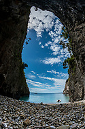 Looking out a large cave on Arid island. New Zealand. Shot with a D800 and a 16mm fisheye lens.