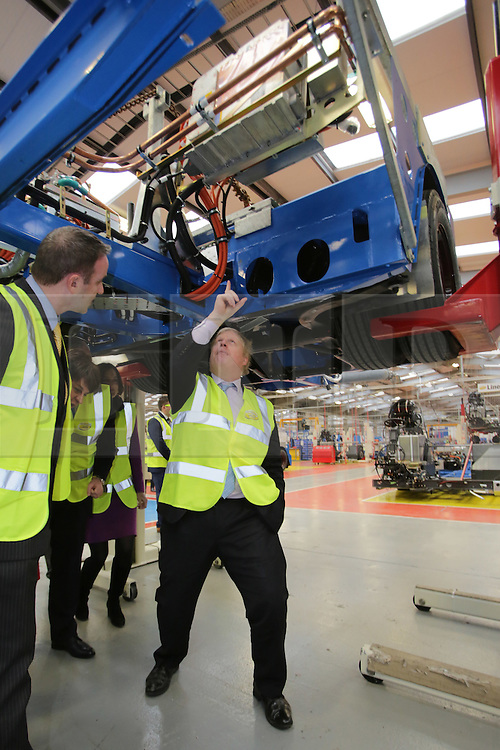 © Licensed to London News Pictures. 29/02/2016. Antrim, Northern Ireland, Mayor of London, Boris Johnson MP, looks under a chassis of a bus during a tour of Wrightbus plant in Antrim,  Northern Ireland. Boris was visiting businesses that are supported by investment from Transport for London. Photo credit : Paul McErlane/LNP