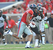 Mississippi tight end Evan Engram (17) runs past Southeast Missouri State's Ben Kargbo (21) to score on a 64 yard pass play at Vaught-Hemingway Stadium in Oxford, Miss. on Saturday, September 7, 2013. (AP Photo/Oxford Eagle, Bruce Newman)