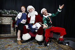 General images of Oklahoma team family members posing for photos with Santa, Wednesday, December 25, 2019, in Atlanta. (Jason Parkhurst via Abell Images for the Chick-fil-A Peach Bowl)