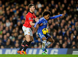 Chelsea Midfielder Willian (BRA) is challenged by Man Utd Midfielder Michael Carrick (ENG) during the match - Photo mandatory by-line: Rogan Thomson/JMP - Tel: 07966 386802 - 19/01/2014 - SPORT - FOOTBALL - Stamford Bridge, London - Chelsea v Manchester United - Barclays Premier League.