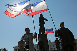 Crimea one day before the referendum. Pro Russian supporters holding a Crimean flag with a statue of Lenin in the background in a pro Russian rally at Simferopol's Lenin Square. Simferopol, . Saturday, 15th March 2014. Picture by Daniel Leal-Olivas / i-Images