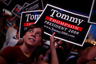 A supporter cheers as U.S. Presidential candidate Tommy Thompson speaks during the Iowa State Straw Poll August 11, 2007 in Ames, Iowa..