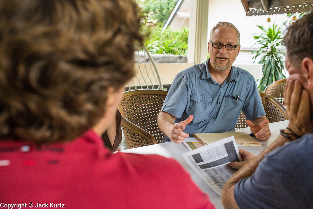 02 APRIL 2013 - PATTAYA, CHONBURI, THAILAND: Scott Bessenecker leads a meeting of the conference coordinators during the New Friars conference at the Ray Resort, in Pattaya, Thailand.     PHOTO BY JACK KURTZ