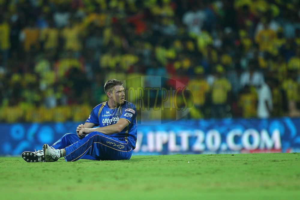 James Faulkner of the Rajasthan Royals looks on as the ball runs to the boundary during match 47 of the Pepsi IPL 2015 (Indian Premier League) between The Chennai Superkings and The Rajasthan Royals held at the M. A. Chidambaram Stadium, Chennai Stadium in Chennai, India on the 10th May 2015.<br /> <br /> Photo by:  Ron Gaunt / SPORTZPICS / IPL