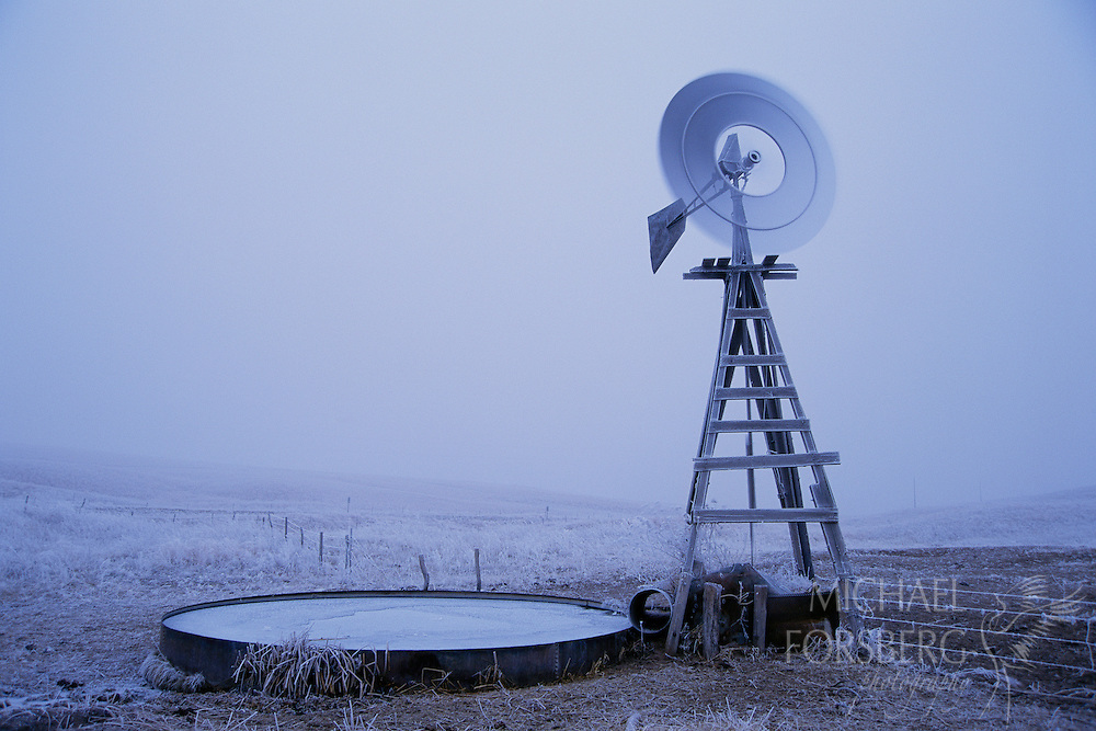Nebraska Sandhills. A winter windmill, an ice-covered cattle tank, and brittle hoarfrost are visible through the fog on a chilly Nebraska sandhills morning. The nation's most extensive and intact wetland/grassland system, the 19,300 mile Nebraska Sandhills provide vital habitat for several species of native fish and for birds in the Great Plains Flyway.