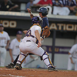 09 June 2008:  Eric Deragisch of UC Irvine beats the tag of LSU catcher Micah Gibbs at home plate to score in the top of the fifth inning making the score 9-2, LSU. The LSU Tigers advanced to the College World Series with a 21-7 victory over the UC Irvine Anteaters in game three of the NCAA Baseball Baton Rouge Super Regional Alex Box Stadium in Baton Rouge, LA..