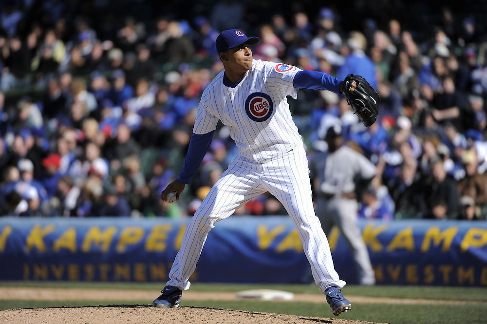 CHICAGO - APRIL 15:  Angel Guzman #37 of the Chicago Cubs pitches against the Colorado Rockies on April 15, 2009 at Wrigley Field in Chicago, Illinois.  The Rockies defeated the Cubs 5-2.  (Photo by Ron Vesely)
