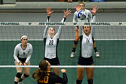 28 October 2016:  Colleen Rynne, Anne Cummings, Deidi Dague during an NCAA womens division 3 Volleyball match between the DePauw Tigers and the Illinois Wesleyan Titans in Shirk Center, Bloomington IL