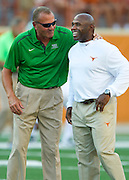 AUSTIN, TX - AUGUST 30:  North Texas Mean Green head coach Dan McCarney and Texas Longhorns head coach Charlie Strong speak before kickoff on August 30, 2014 at Darrell K Royal-Texas Memorial Stadium in Austin, Texas.  (Photo by Cooper Neill/Getty Images) *** Local Caption *** Dan McCarney; Charlie Strong