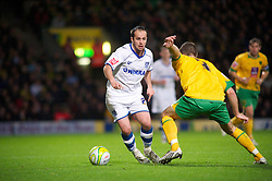 NORWICH, WALES - Saturday, November 14, 2009: Tranmere Rovers' Chris Shuker and Norwich City's Adam Drury in action during the League One match at Carrow Road. (Pic by David Rawcliffe/Propaganda)