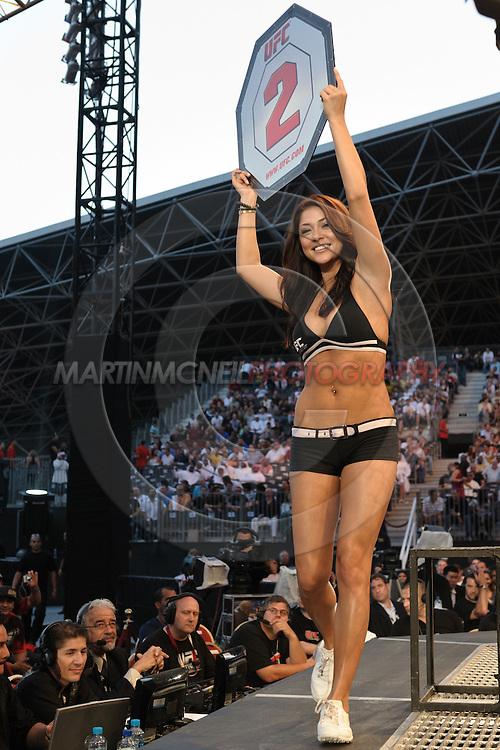 "ABU DHABI, UNITED ARAB EMIRATES, APRIL 10, 2010: Arianny Celeste walks on teh cage apron between rounds during ""UFC 112: Invincible"" inside Ferari World, Abu Dhabi on April 10, 2010."
