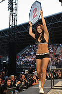 "ABU DHABI, UNITED ARAB EMIRATES, APRIL 10, 2010: Arianny Celeste walks on teh cage apron between rounds during ""UFC 112: Invincible"" inside Ferari World, Abu Dhabi on April 10, 2010."