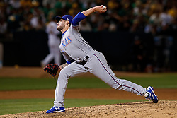 OAKLAND, CA - SEPTEMBER 21: Joe Palumbo #62 of the Texas Rangers pitches against the Oakland Athletics during the sixth inning at the RingCentral Coliseum on September 21, 2019 in Oakland, California. The Oakland Athletics defeated the Texas Rangers 12-3. (Photo by Jason O. Watson/Getty Images) *** Local Caption *** Joe Palumbo