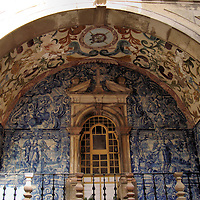 City Gate Azulejo in Óbidos, Portugal<br /> An azulejo is a type of earthenware tile that since the 15th century was usually decorated with figures and then glazed before becoming an architectural element.  This art form was introduced in Portugal by the Moors.  This blue azulejo called Niche Faïencée is over the Porta da Vila city gate in Óbidos.