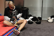 MANCHESTER, ENGLAND, NOVEMBER 11, 2009: Brandon Vera wraps his hands ahead of padwork training during the open work-outs for UFC 105 at the Crowne Plaza Hotel in Manchester, England on November 11, 2009.