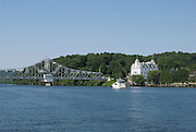 The Goodspeed Opera House and adjacent bridge over the Connecticut River as viewed from the Connecticut River.  This historical Victorian theater was built in 1876.