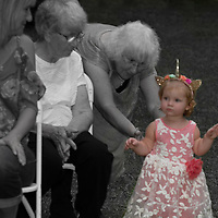 Great Grandma is helping the youngest Brides maid down the isle.
