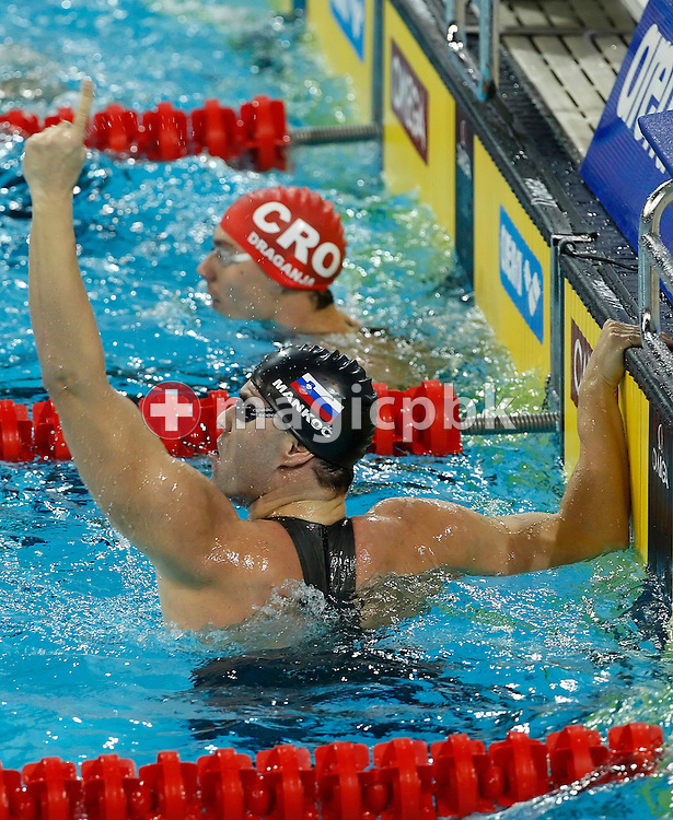 Peter MANKOC (front) of Slovenia jubilates after clocking first in a new World Record time in the men's 100m Individual Medley Semifinal 1 at the 13th European Short Course Swimming Championships in Istanbul, Turkey, Saturday, Dec. 12, 2009. (Photo by Patrick B. Kraemer / MAGICPBK)