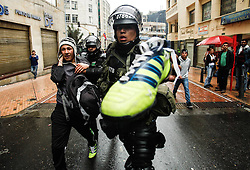 59594101  .Policemen arrest a man during a protest in commemoration of the International Labour Day in Bogota, capital of Colombia, May 1, 2013,  May 2, 2013 Photo by: i-Images.UK ONLY