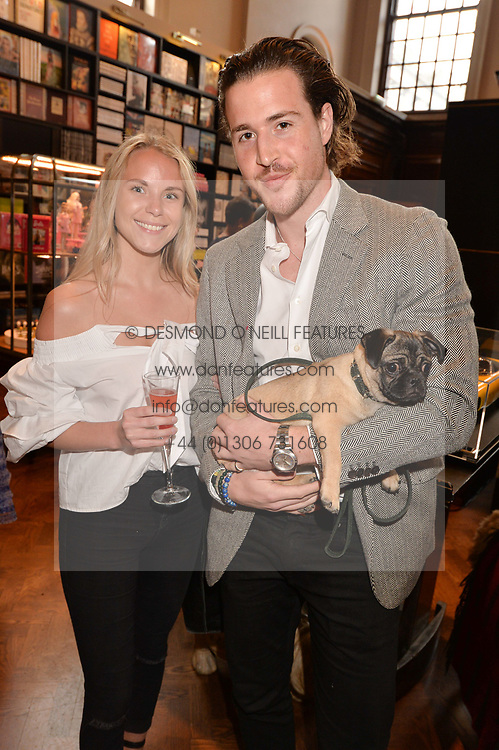 Karoline Rydningen and Tom Buchanan with Monkey the dog at The Art of @barbiestyle Book Launch held at Maison Assouline, Piccadilly, London on 15 June 2017.Photo by Dominic O'Neill/SilverHub 0203 174 1069/ 07711972644 - Editors@silverhubmedia.com
