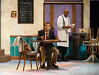 "Marcus Wells ""Hally"" works on his English composition while Erick Lindsey ""Willy"" cleans up at St. George's Tea Room during dress rehearsal for ""Master Harold and the Boys"" at the Winnipesaukee Playhouse.  (Karen Bobotas/for the Laconia Daily Sun)"
