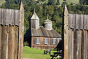 "Originally built in the 1820s, the restored chapel at Fort Ross was the first Russian Orthodox structure in North America outside of Alaska. Fort Ross State Historic Park preserves a former Russian colony (1812-1842) on the west coast of North America, in what is now Sonoma County, California, USA. The 5.5-inch howitzer cannons are historical reproductions. Visit Fort Ross and dramatic coastal scenery 11 miles north of Jenner on California Highway One. For centuries before Europeans arrived, this site was called Metini and had been occupied by the Kashaya band of Pomo people who wove intricate baskets and harvested sea life, plants, acorns, deer, and small mammals. Sponsored by the Russian Empire, ""Settlement Ross"" was multicultural, built mostly by Alaskan Alutiiq natives and occupied by a few Russians plus 300-400 native Siberians, Alaskans, Hawaiians, Californians, and mixed Europeans. Initially, sea otter pelts funded Russian expansion, but by 1820, overhunting motivated the Russian-American Company to introduce moratoriums on hunting seals and otters, the first marine-mammal conservation laws in the Pacific. Russian voyages greatly expanded California's scientific knowledge. Renamed ""Ross"" in 1812 in honor of Imperial Russian (Rossiia), Fortress Ross was intended to grow wheat and other crops to feed Russians living in Alaska, but after 30 years was found to be unsustainable. Fort Ross was sold to John Sutter in 1841, and his trusted assistant John Bidwell transported its hardware and animals to Sutter's Fort in the Sacramento Valley. Fort Ross is a landmark in European imperialism, which brought Spanish expanding west across the Atlantic Ocean and Russians spreading east across Siberia and the Pacific Ocean. In the early 1800s, Russians coming from the north met Spanish coming from the south along the Pacific Coast of California, followed by the USA arriving from the east in 1846 for the Mexican-American War. Today, Fort Ross is a California Historical Landmar"