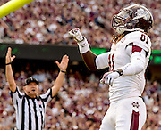Nov 9, 2013; College Station, TX, USA; Mississippi State Bulldogs wide receiver De'Runnya Wilson (81) celebrates catching a touchdown pass against the Texas A&M Aggies during the second quarter at Kyle Field. Mandatory Credit: Thomas Campbell-USA TODAY Sports