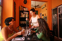 Carolina Vélez, the co-owner of Oh! Lá Lá, serves champagne for guests at the small yet very popular restaurant in Cartagena, on Saturday, August 23, 2008. (Photo/Scott Dalton).