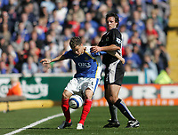 Photo: Lee Earle.<br /> Portsmouth v Blackburn Rovers. The Barclays Premiership. 08/04/2006. Pompey's Andres D'Alessandro (L) battles with Lucas Neill.