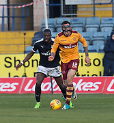 24th February 2018, Dens Park, Dundee, Scotland; Scottish Premier League football, Dundee versus Motherwell; Ryan Bowman of Motherwell and Genseric Kusunga of Dundee