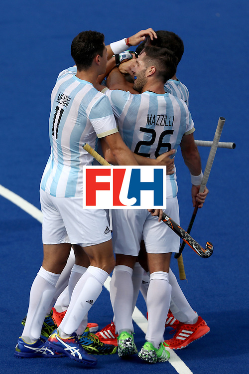 RIO DE JANEIRO, BRAZIL - AUGUST 08:  Joaquin Harmotto Menini #11 and Agustin Mazzilli #26 of Argentina celebrate a goal against Argentina during a Men's Pool B match on Day 3 of the Rio 2016 Olympic Games at the Olympic Hockey Centre on August 8, 2016 in Rio de Janeiro, Brazil.  (Photo by Sean M. Haffey/Getty Images)