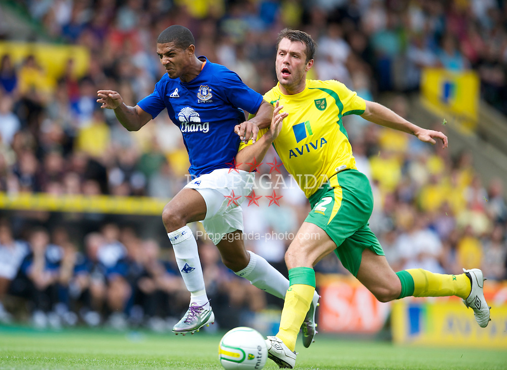 NORWICH, ENGLAND - Saturday, July 31, 2010: Everton's Jermaine Beckford in action against Norwich City's Elliott Ward during a preseason friendly match at Carrow Road. (Pic by David Rawcliffe/Propaganda)