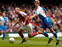 Picture: Henry Browne.<br /> Date: 16/04/2005.<br /> Arsenal v Blackburn FA Cup Semi-Final.<br /> Fredrik Ljungberg of Arsenal is taken out by Morten Gamst Pedersen of Rovers.