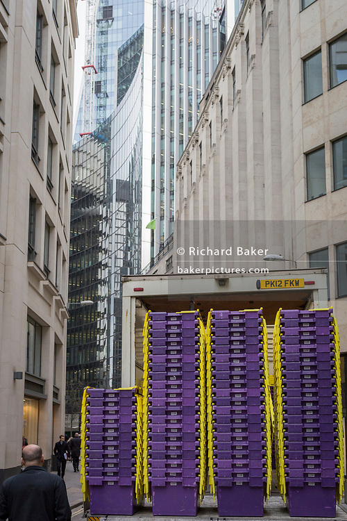 A stack of empty removals packing crates await unloading during a company move in the City of London, on 27th February 2018, in London, England.