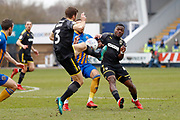AFC Wimbledon defender Jonathan Meades (3) and AFC Wimbledon defender Adedeji Oshilaja (4) challenge for the ball during the EFL Sky Bet League 1 match between Shrewsbury Town and AFC Wimbledon at Greenhous Meadow, Shrewsbury, England on 24 March 2018. Picture by Simon Davies.