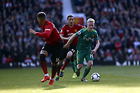 Football - 2018 / 2019 Premier League - Manchester United vs. Watford<br /> <br /> Will Hughes of Watford runs at Marcos Rojo of Manchester United as Nemanja Matic looks on, at Old Trafford.<br /> <br /> COLORSPORT/ALAN MARTIN