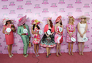 Jody DeFord, center, of Indianapolis, reacts after winning the Longines Kentucky Oaks Fashion Contest and a Longines timepiece on Kentucky Oaks Day, Friday, May 1, 2015, in Louisville, Ky. Longines, the Swiss watch manufacturer known for its luxury timepieces, is the Official Watch and Timekeeper of the 141st annual Kentucky Derby. (Photo by Diane Bondareff/Invision for Longines/AP Images)