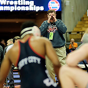 Kris Wilson/News Tribune<br /> Jefferson City head coach Phil Cagle uses a break in the action to yell out instructions to Jay wrestler Rashaun Woods as he battles Trey Storey of Blue Springs South in their Class 4 182-pound opening round<br /> match during the 2016 MSHSAA Wrestling State Championships at Mizzou Arena in Columbia.