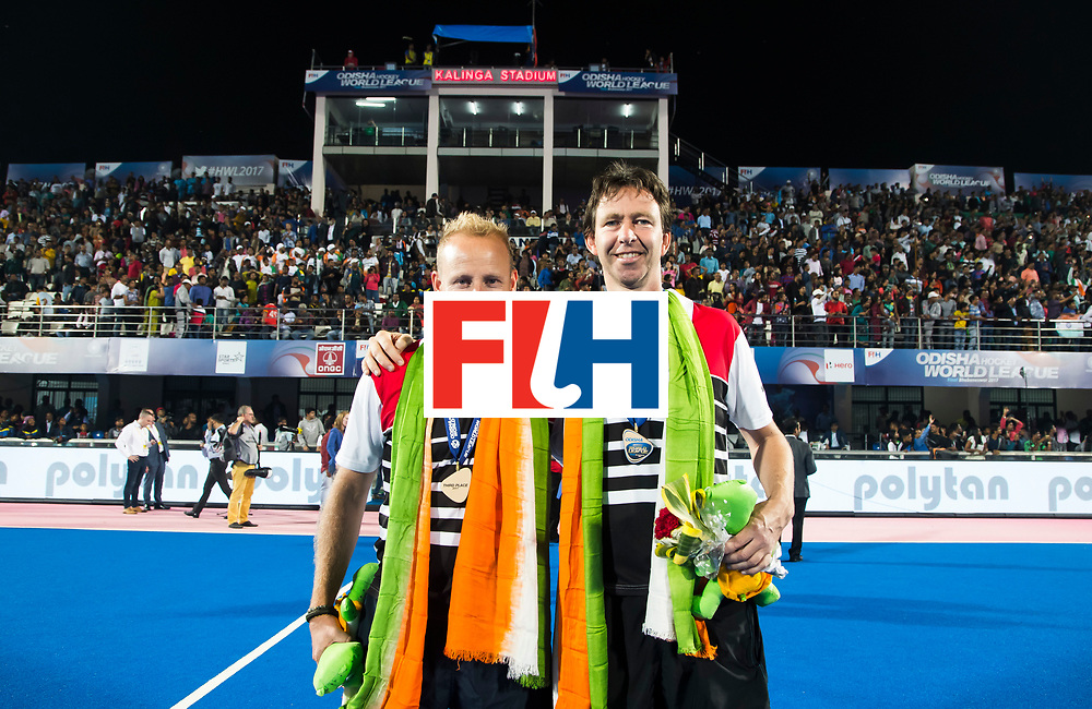 BHUBANESWAR - Hockey World League finals Match for bronze , Germany v India (1-2). coach Sjoerd Marijne (Ind) with assistant-coach Raoul Ehren (Ind) . COPYRIGHT KOEN SUYK