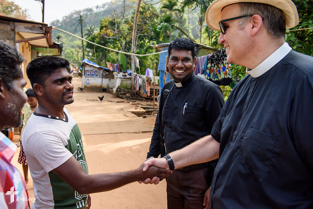 The Rev. P. Gnanakumar introduces the Rev. Steven Mahlburg, LCMS career missionary to Sri Lanka, to residents of the Eila rubber plantation in the Sabaragamuwa Province of Sri Lanka as they conduct church member home visitations on Saturday, Jan. 20, 2018. LCMS Communications/ Erik M. Lunsford